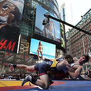 Dillon Artiglieri, left), New Jersey, in action against Adis Radoncic, New York City, during the 'Beat The Streets' USA Vs The World, International Exhibition Wrestling in Times Square. New York, USA. 7th May 2014. Photo Tim Clayton