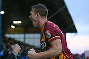 Bradford City defender Anthony McMahon (29) celebrates Bradford City defender Rory McArdle (23)  goal to make the score 1-2 during the EFL Sky Bet League 1 match between Oldham Athletic and Bradford City at Boundary Park, Oldham, England on 28 January 2017. Photo by Simon Davies.