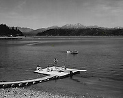 Vacationists relaxed and fished in a typical summer scene at Hood Canal, near Union, Mason County. (Josef Scaylea / The Seattle Times, 1957)