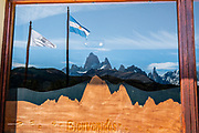 """Cerro Fitz Roy (3405 m or 11,171 ft elevation), seen from the Los Glaciares National Park Visitor Center in El Chalten, Santa Cruz Province, Argentina, Patagonia, South America. Monte Fitz Roy is also known as Cerro Chaltén, Cerro Fitz Roy, or Mount Fitz Roy. The first Europeans recorded as seeing Cerro Fitz Roy were the Spanish explorer Antonio de Viedma and his companions, who in 1783 reached the shores of Viedma Lake. In 1877, Argentine explorer Francisco Moreno saw the mountain and named it Fitz Roy in honour of Robert FitzRoy who, as captain of HMS Beagle, had travelled up the Santa Cruz River in 1834 and charted large parts of the Patagonian coast. Mt Fitz Roy was first climbed in 1952. Cerro is a Spanish word meaning hill, while Chaltén comes from a Tehuelche word meaning """"smoking mountain"""", due to clouds that usually form around the peak.  Los Glaciares National Park and Reserve are honored on UNESCO's World Heritage List."""