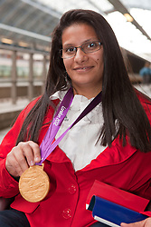© under license to London News Pictures. 25/06/12..Souhad Ghazouani, gold medalist in the women's powerlifting at the Eurostar as the French Paralympic team depart London on a specially charted Eurostar train...ALEX CHRISTOFIDES/LNP