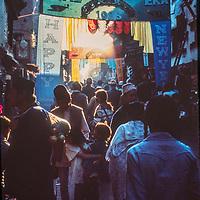 Crowds swarm a narrow street in Kathmandu, Nepal.