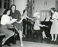 1950s Dorothy Malone joins other ladies singing at the Hollywood Studio Club