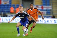 Joe Ralls of Cardiff city holds off Rajiv Van La Parra of Wolverhampton Wanderers.  Skybet football league championship match, Cardiff city v Wolverhampton Wanderers at the Cardiff city stadium in Cardiff, South Wales on Saturday 22nd August 2015.<br /> pic by Andrew Orchard, Andrew Orchard sports photography.