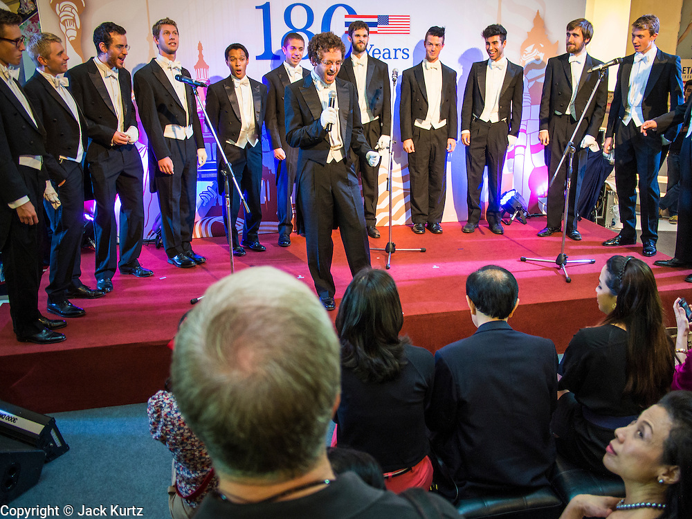 """19 JULY 2013 - BANGKOK, THAILAND:  REUBEN HENDLER, a  Yale senior cognitive studies major, fronts the Whiffenpoofs during their show in Bangkok Friday. The Yale Whiffenpoofs, one of the best-known collegiate a cappella groups in the world performed in CentralWorld in Bangkok Friday. Founded in 1909, the """"Whiffs"""" began as a senior quartet that met for weekly concerts at Mory's Temple Bar, the famous Yale tavern. The Bangkok stop was a part of their 2013 world tour and was sponsored by the US Embassy. They sang at the opening of a photo exhibit that marked 180 years of friendly diplomatic relations between Thailand and the United States.    PHOTO BY JACK KURTZ"""