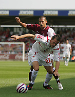 Photo: Lee Earle. <br /> Northampton Town v Swindon Town. Coca Cola Championship. 11/08/2007. <br /> Swindon's Ibon Arieta (F) battles with Jason Crowe.