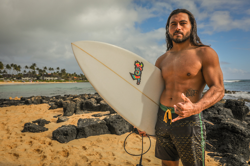 """""""I do construction and take care of my folks.  If at all possible, I surf every day.""""  -Kele Hanohano heads home after an afternoon of surfing at Poipu Beach, Kauai, Hawaii."""