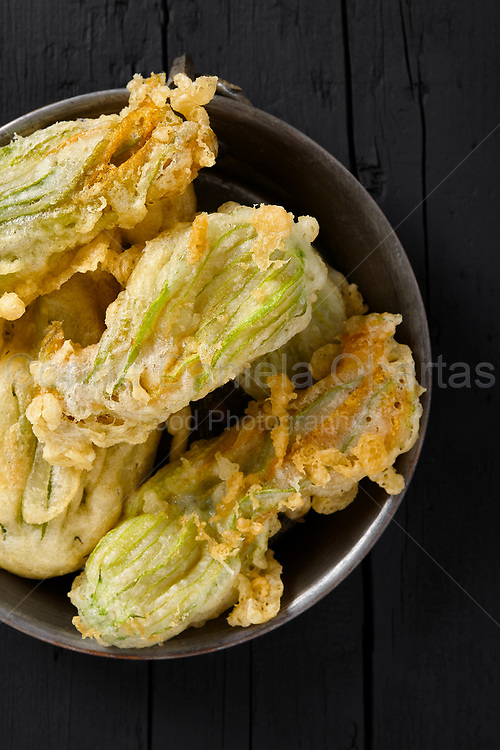 Plate with fried zucchini flowers, typical plate of the Italian cuisine. Top view shot.