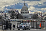 Police at a check point at the captiol checking cars before they can enter the metal fence put up  in Washington DC to secure Biden's inuguration after the insurgency on Jan. 6, 2021.