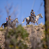 Aaron Hammond holds his son Bryn Hammond as they lead riders along a ridge line in Continental Divide Saturday.