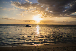 Fishing boat on sea at sunset, Mauritius