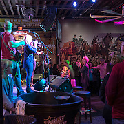 A band is seen through a doorway as they perform in a bar on Music Row in downtown Nashville, Tennessee on Friday, November 13, 2015. (Alex Menendez via AP)