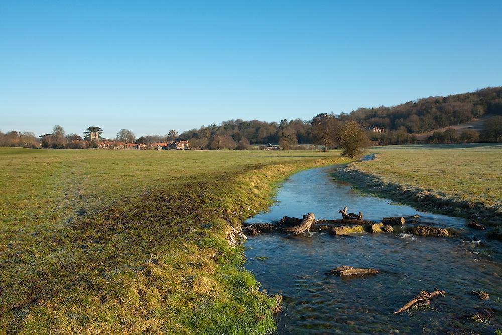 View across the water meadows in the Chilterns towards Hambleden Village, Buckinghamshire, Uk