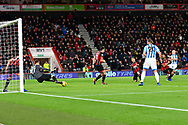 Asmir Begovic (27) of AFC Bournemouth saves the shot at goal from Aaron Mooy (10) of Huddersfield Town during the Premier League match between Bournemouth and Huddersfield Town at the Vitality Stadium, Bournemouth, England on 4 December 2018.