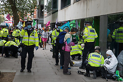 London, UK. 3rd September, 2020. Metropolitan Police officers arrest climate activists from Extinction Rebellion who had occupied the street outside the Department of Transport in protest against roadbuilding. Extinction Rebellion activists are attending a series of September Rebellion protests around the UK to call on politicians to back the Climate and Ecological Emergency Bill (CEE Bill) which requires, among other measures, a serious plan to deal with the UK's share of emissions and to halt critical rises in global temperatures and for ordinary people to be involved in future environmental planning by means of a Citizens' Assembly.
