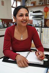 Social worker working in kitchen.