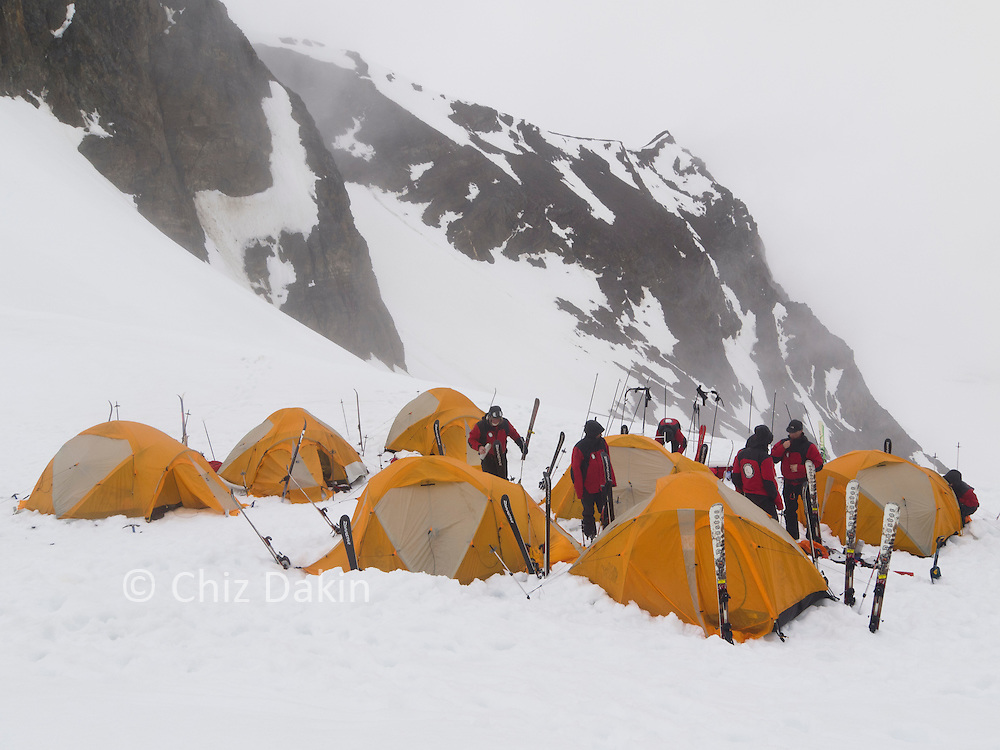 Expedition camp on Trident Col (Shackleton's Traverse, South Georgia). Skis standing on end as tent poles.