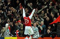 Photo: Ed Godden.<br /> Arsenal v Hamburg. UEFA Champions League, Group G. 21/11/2006. Arsenal's Emmanuel Eboue celebrates his goal.