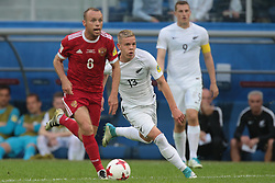 June 17, 2017 - Saint Petersburg, Russia - Denis Glushakov (L) of the Russian national football team and Monty Patterson of the New Zealand national football team vie for the ball during the 2017 FIFA Confederations Cup match, first stage - Group A between Russia and New Zealand at Saint Petersburg Stadium on June 17, 2017 in St. Petersburg, Russia. (Credit Image: © Igor Russak/NurPhoto via ZUMA Press)