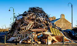 The huge Biggar hogmanay bonfire in the High Street, which will be lit by local resident Bobby Boyd MBE at 9.30pm tonight (Hogmanay - 31st December 2019).<br /> <br /> This is probably the biggest new year bonfire anywhere in the UK and continues a tradition going back hundreds of years.<br /> <br /> <br /> (c) Andrew Wilson | Edinburgh Elite media
