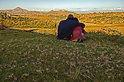 Bennett Nkokana, 30 and Adellina Kholu, 25, sit and talk by the side of the road on the outskirts of Holtse, Lesotho.