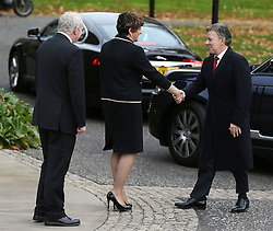 Colombia's president Juan Manuel Santos (right) is welcomed by First Minister Arlene Foster (centre) and Deputy First Minister Martin McGuinness on arrival at Stormont Castle, Belfast, during a state visit.