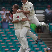 Michael Hussey jumps on Nathan Hauritz as Peter Siddle congratulates after the dismissal of Misbah-ul-Haq during the Australia V Pakistan 2nd Cricket Test match at the Sydney Cricket Ground, Sydney, Australia, 6 January 2010. Photo Tim Clayton