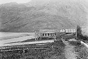 9707-K243. fish drying rack, buildings on the shore of Unalaska Harbor. June 22-24, 1917 Alaska