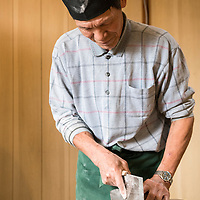 Soba noodle making at Teuchi Soba near Goku on Dogo, the largest island of the Oki Islands, Shimane Prefecture, Japan. Soba noodles are unique on the Oki Islands because they use 100% buckwheat. All people in images are model released; soba maker is Kobo Omi, woman making noodles is Kay Allen (from NGTO), and young man making noodles is Masayuki Saito.