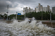Pohang, South Korea - September 23, 2019: Swells from a passing typhoon break against the waterfront in Pohang.