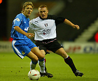 Photo. Aidan Ellis.<br />Wigan Athletic v Fulham.<br />Carling Cup 2nd Round.<br />23/09/2003.<br />Wigan's Jimmy Bullard and Fulham's Mark Pembridge
