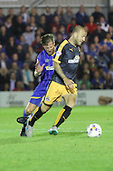 Dannie Bulman of AFC Wimbledon during Sky Bet League 2 match between AFC Wimbledon and Cambridge United at the Cherry Red Records Stadium, Kingston, England on 18 August 2015. Photo by Stuart Butcher.