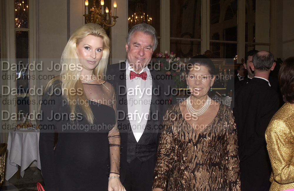 Jacqueline and David Siegel and Princess  Irina Strozzi. Crillon Debutantes Ball 2002. Paris. 7 December 2002. © Copyright Photograph by Dafydd Jones 66 Stockwell Park Rd. London SW9 0DA Tel 020 7733 0108 www.dafjones.com