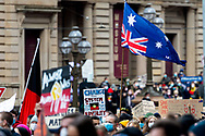 The Australian national flag is held upside down by a protestor to show support on 06 June, 2020 in Melbourne, Australia. This event was organised to rally against aboriginal deaths in custody in Australia as well as in unity with protests across the United States following the killing of an unarmed black man George Floyd at the hands of a police officer in Minneapolis, Minnesota. (Photo by Mikko Robles/ Speed Media)