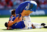 Photo: Richard Lane/Sportsbeat Images.<br />Manchester United v Chelsea. FA Community Shield. 05/08/2007. <br />Chelsea's Florent Malouda lies injured as Frank Lampard congratulates him on his goal.