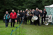 The Hardraw Scaur Brass Band Festival. Tintwistle band prepare for their performance. Organised by the Yorkshire and Humberside Brass Band Association, the competition is Britain's second oldest outdoor contest and takes place annually in Hardraw Scar in Wensleydale, North Yorkshire, England, UK. The area, a natural amphitheatre, attracts bands from all over the North of England and is a popular event amongst players and audiences alike.
