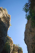 Steep cliff face of Ej Tajo gorge in Ronda, Spain