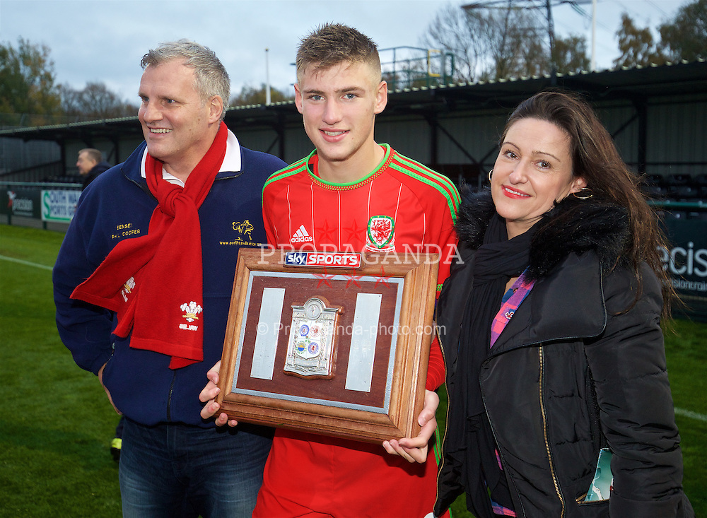 NEWPORT, WALES - Thursday, November 5, 2015: Wales' Brandon Cooper celebrates with his parents after a 3-1 victory over Northern Ireland during the Under-16's Victory Shield International match at Dragon Park. (Pic by David Rawcliffe/Propaganda)