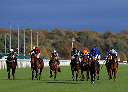 Al Hajar (Sixth right) ridden by William Buick wins the Scott Dobson Memorial Nursery Handicap Stakes during Racing Post Trophy day at Doncaster Racecourse.