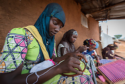 3 June 2019, Djohong, Cameroon: 17-year-old refugee Honeisatou Hamadou from Botoga in CAR works on an embroidered blanket. She is one of five trainees learning embroidery at a shop in the Borgop refugee camp, as part of a vocational training effort by the Lutheran World Federation's World Service programme, intended to help particularly young refugees make an income. The Borgop refugee camp is located in the municipality of Djohong, in the Mbere subdivision of the Adamaoua regional state in Cameroon. Supported by the Lutheran World Federation since 2015, the camp currently holds 12,300 refugees from the Central African Republic.