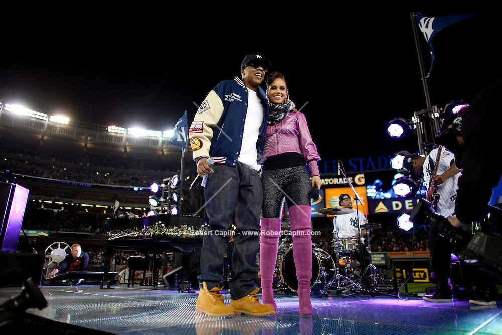 Recording artists Jay-Z and Alicia Keys perform prior to Game 2 of the 2009 World Series between the New York Yankees and The Philadelphia Phillies in Bronx, NY. (Photo by Robert Caplin)<br /> <br /> ***NO SALES TO:<br /> Rolling Stone<br /> People<br /> US Weekly<br /> OK! Magazine