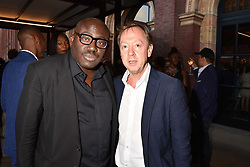 Edward Enninful and Geordie Greig at the Victoria & Albert Museum's Summer Party in partnership with Harrods at The V&A Museum, Exhibition Road, London, England. 20 June 2018.
