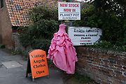 A pink party dress is displayed outside a vintage clothing busness, on 14th August 2020, in Aldeburgh, Norfolk, England.