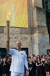 © Licensed to London News Pictures. 26/07/2012. London, UK.  London 2012 Olympics - the Olympic Torch starts the penultimate day (Day 69) of the Olympic Torch Relay at the Camden Roundhouse.  Team GB's deputy Chef de Mission Clive Woodward is the first torch bearer of the day.  Clive also managed the England rugby team to victory in the 2003 World Cup.Photo credit : Richard Isaac/LNP