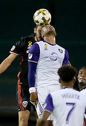 September 9, 2017 - Washington, DC, USA - 20170909 - D.C. United defender STEVE BIRNBAUM (15), back, and Orlando City FC forward GILES BARNES (14) battle for a head ball in the first half at RFK Stadium in Washington. (Credit Image: © Chuck Myers via ZUMA Wire)