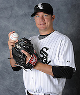 CHICAGO - AUGUST 08:  Jake Peavy #44 of the Chicago White Sox poses for a portrait on August 8, 2009 at U.S. Cellular Field in Chicago, Illinois.  (Photo by Ron Vesely)