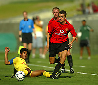 Photo Aidan Ellis.<br />Manchester United v Club America. (at The Coliseum Stadium in Los Angeles). 27/07/03.<br />United's Danny Pugh bursts up the wing leaving Club America's Ricardo Rojas on the floor