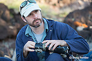 NOAA researcher Dr. Charles Littnan prepares a Crittercam and tracking instrumentation package which he will attach to a Hawaiian monk seal, west end of Molokai, Hawaii, USA, Ho ike a Maka Project
