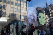 British royal family merchanidise and tourism souvenir masks which show the faces of the Duke and Duchess of Sussex Prince Harry and Meghan Markle on their wedding day, on display in the window of trinket shop in Oxford Street, on 15th January 2020, in London, England.
