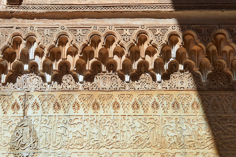 Berber arabesque Morcabe and honeycombe Muqarnas plasterwork of the 14th century Ben Youssef Madersa (Islamic college) re-constructed by the Saadian Sultan Abdallah al-Ghalib in 1564 as the largest and most prestigious Medersa in Morocco. Marrakesh, Morroco .<br /> <br /> Visit our MOROCCO HISTORIC PLAXES PHOTO COLLECTIONS for more   photos  to download or buy as prints https://funkystock.photoshelter.com/gallery-collection/Morocco-Pictures-Photos-and-Images/C0000ds6t1_cvhPo<br /> .<br /> <br /> Visit our ISLAMIC HISTORICAL PLACES PHOTO COLLECTIONS for more photos to download or buy as wall art prints https://funkystock.photoshelter.com/gallery-collection/Islam-Islamic-Historic-Places-Architecture-Pictures-Images-of/C0000n7SGOHt9XWI